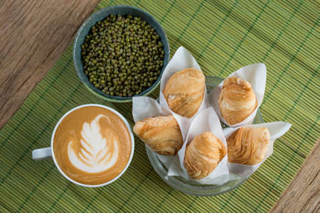 Set of curry puff on wood table.