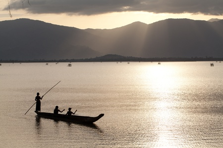 Peaceful landscape of people boating on a river in Vietnam