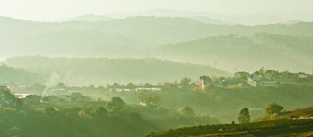 Scene of layers of mountains of Da Lat, a highland city located in a valley. Location: Da Lat City, Vietnam