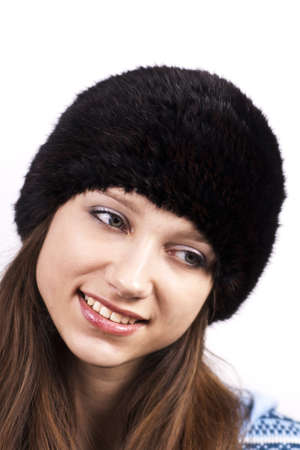 beautiful smiling girl in a cap  isolated on a white background photo