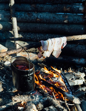 Mulled wine in a pot over a campfire hike.