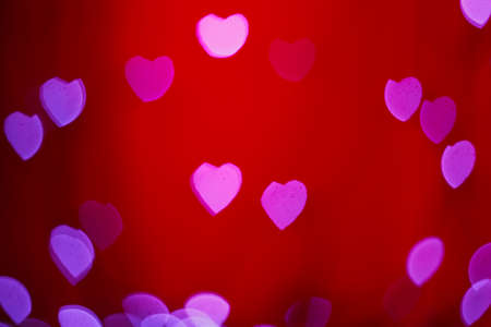 Boke Lovers of the heart on a red background Stock Photo
