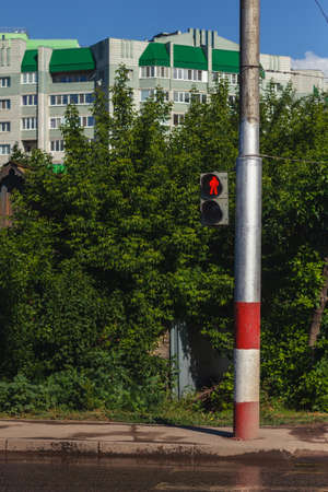 to warn: Traffic light with red sign for walkers to stop in urban ambiance