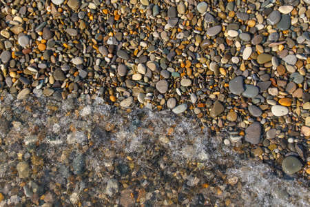 Abstract background with stones. Pebbles, coast. Abstract background with stones. Banco de Imagens