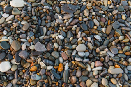 Abstract background with stones. Pebbles, coast. Abstract background with stones. Reklamní fotografie