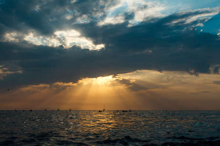 beautiful sunset on the sea against the background of the silhouette of ships,