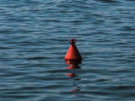 red buoy, dark blue summer lake Imagens