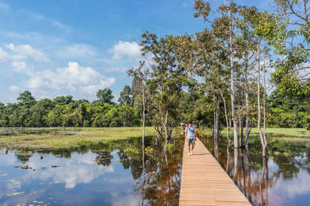 SIEM REAP, CAMBODIA - OCTOBER 19, 2016: The path towards to Neak Pean temple on artificial island. Angkor.