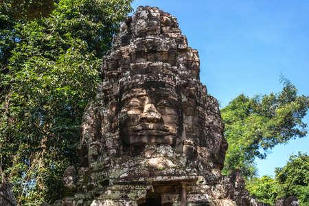 The stone head of Avalokiteshvara near Banteay Kdei temple, Cambodia