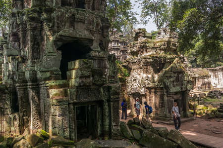 People are walking in Ta Prohm temple in Angkor. Editorial