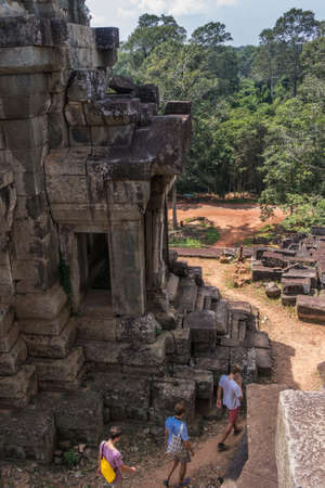 People are walking in Ta Keo temple in Angkor, Siem Reap, Cambodia