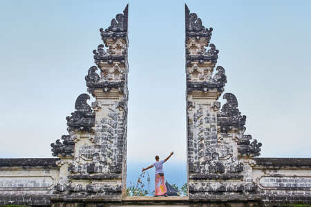 Man is standing in the gate of Lempuyang temple on Bali isalnd, Indonesia