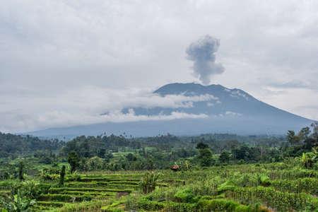 Agung volcano eruption view near rice fields, Bali, Indonesia