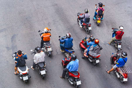 People are on motorbikes in huge Asian city