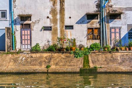 Thai houses along Khlong Rob Krung Canal in Bangkok, Thailand