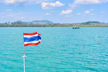 Ferry with thai flag to Koh Chang Island in Trat, Thailand Stock Photo