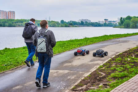 Friends are playing with radio-controlled car