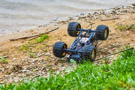 Radio-controlled car turned over Stock Photo