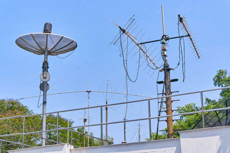 Radio and Satellite antennas on the blue sky Stock Photo