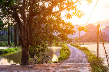 Mountains sunset view with bicycle in Ninh Binh, Vietnam