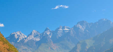 QIAOTOU, CHINA, NOVEMBER 20, 2013: view of the jade dragon snow mountain taking from the upper path of tiger leaping gorge track in china.