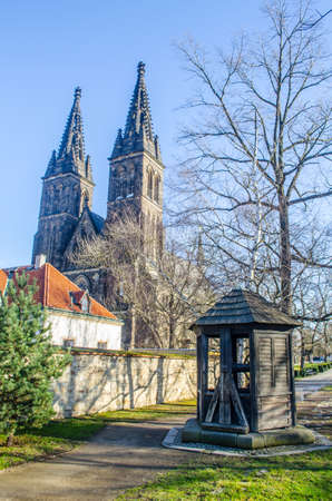 unesco in czech republic: wooden shed is situated in front of the basilica of saint peter and paul in vysehrad castle complex in prague.