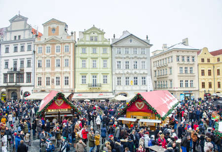 PRAGUE, CZECH REPUBLIC, JANUARY 30, 2015: every year christmas market is held on old town square in prague and thousands of tourists come there to buy some souvenier.