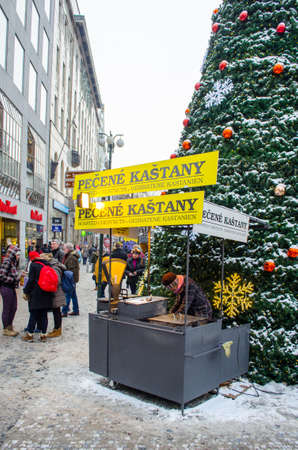 PRAGUE, CZECH REPUBLIC, JANUARY 30, 2015: hot chestnut is a prague winter speciality and it is being sold on every corner during christmas time.