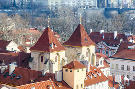 medieval towers of a merchant building are erected in the center of prague.