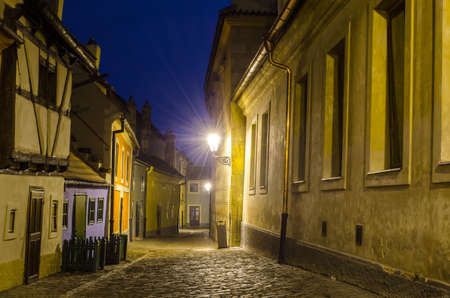 night view of the illuminated golden lane street inside of the grounds of Prague castle.