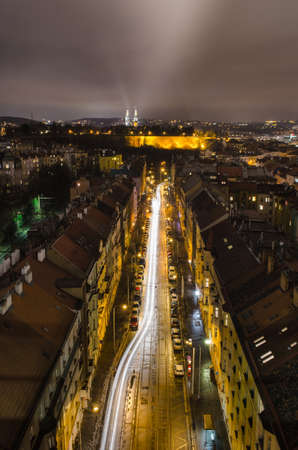 night view of vysehrad castle and surrounding area taken from the top of nuselsky bridge in prague.