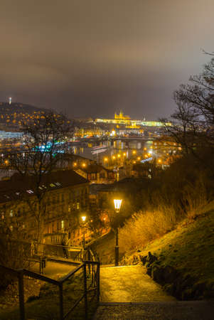 steep stairway leading to the vysehrad castle with prague panorama and the prague castle behind it.
