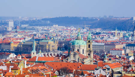 panorama view of prague taken from the strahov monastery with saint nicolas church in front.