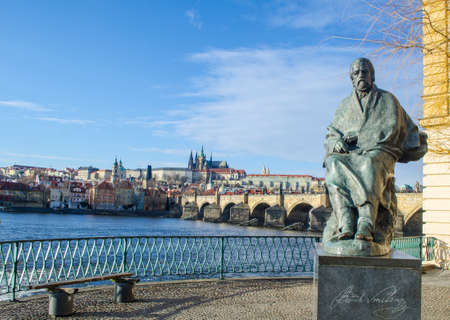 composer: statue of composer bedrich smetana with prague castle and charles bridge behind it.