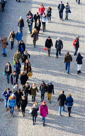 PRAGUE, CZECH REPUBLIC, JANUARY 30, 2015: aerial view of the people crossing charles bridge in prague.
