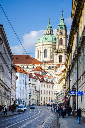 saint nicolas: PRAGUE, CZECH REPUBLIC, JANUARY 30, 2015: People are walking from the charles bridge towards the saint nicolas church in hradcany district in Prague. Editorial