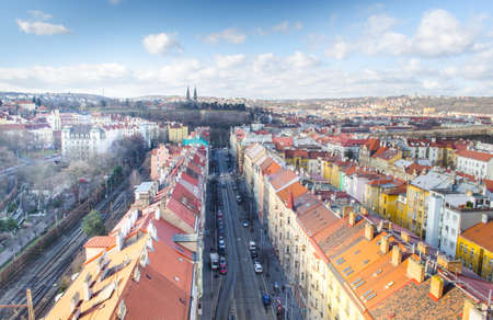view of prague taken from nuselsky bridge captures typical local architecture from aerial perspective. Famous vysehrad castle is behind it.