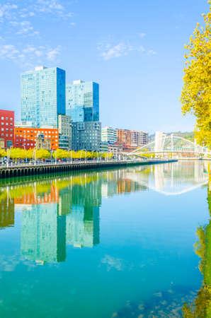 Waterfront of the Nervion river with zubizuri bridge in Bilbao, Spain