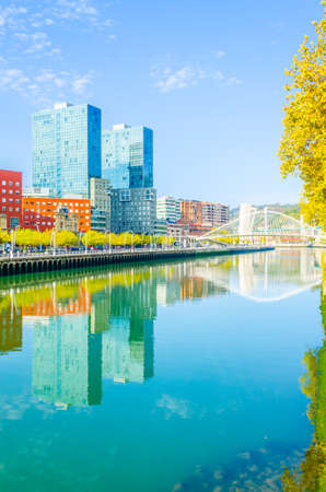 Waterfront of the Nervion river with zubizuri bridge in Bilbao, Spain Stock Photo - 101200877
