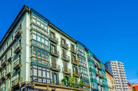 Colorful houses on a street in Bilbao, Spain