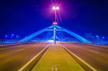 Night view of puente del tercer millenio bridge in Zaragoza, Spain