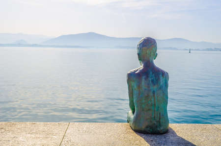 View of a statue of raqueros on waterfront in Santander, Spain