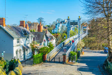 View of residential houses alongside river Dee in Chester, England