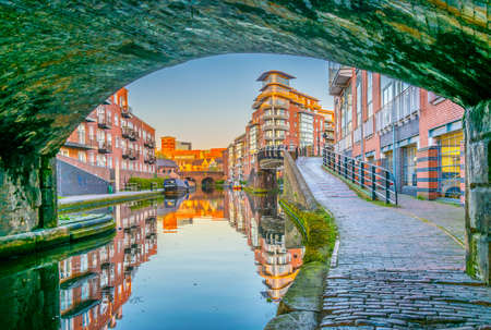 Sunset view of brick buildings alongside a water channel in the central Birmingham, England  Stock Photo