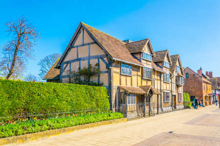 People are strolling next to the birth house of William Shakespeare in Stratford upon Avon, England