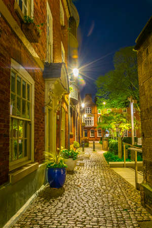 Night view of an alley passing cathedral in Leicester, England 스톡 콘텐츠