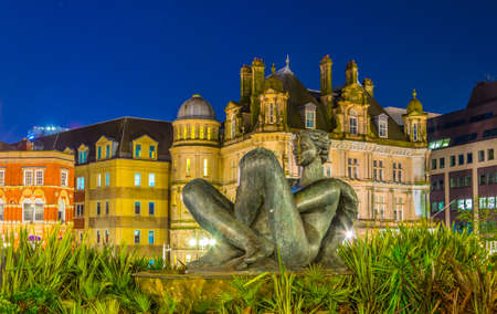 Night view of the river fountain in front of the Victoria square in Birmingham, England  Editorial