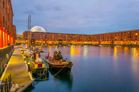 Night view of illuminated albert dock in Liverpool, England  Stock Photo