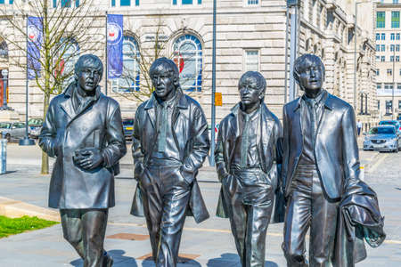Statue of the Beatles in front of the royal liver building in Liverpool, England 写真素材 - 102256032
