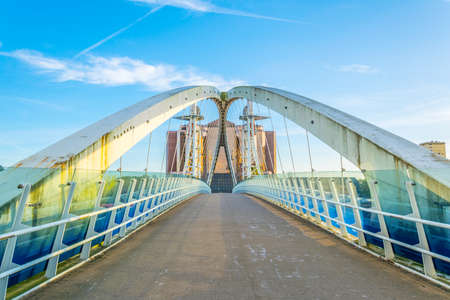 View of a footbridge in Salford quays in Manchester, England  Banco de Imagens